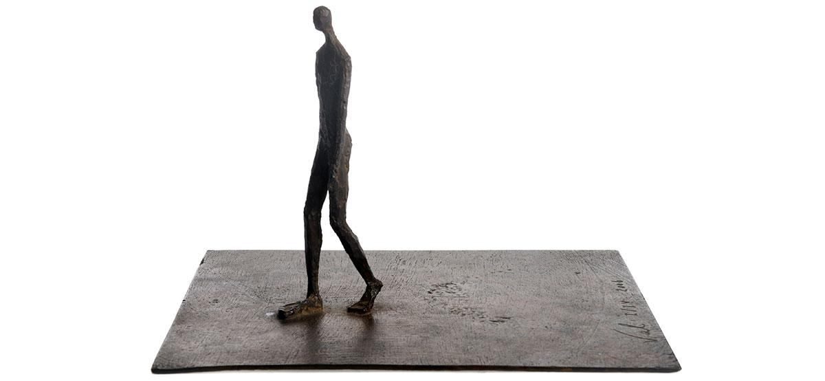Walking on plate bronze sculpture by French sculptor Val - Valérie Goutard - with Sculptureval