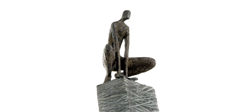 Crouching man on high square pedestal by French sculptor Val - Valérie Goutard - with Sculptureval